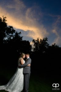 Married couple at The Hollow at Paris Mountain wedding at sunset.