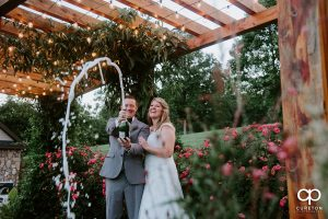 Bride and Groom popping teh cork on some champagne after their Greenville SC wedding.