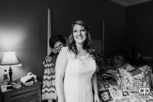 Bride putting on her dress.