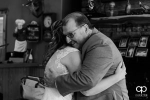 Bride hugging her father when he sees her before the wedding ceremony.