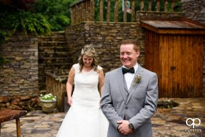 Groom smiling before the first look before the wedding ceremony at The Hollow at Paris Mountain.