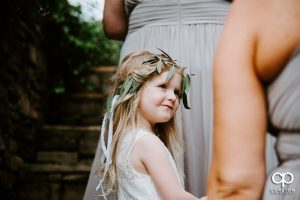 Flower girl looking at the bride.