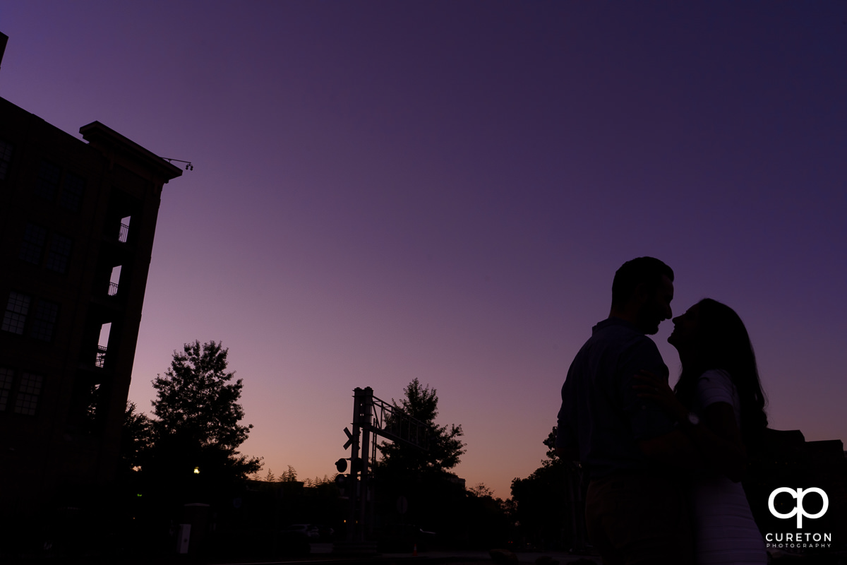 Silhouette of an engaged couple.