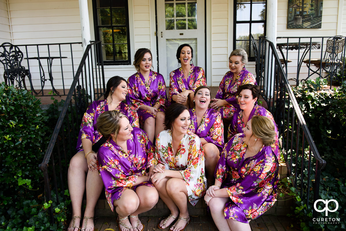 Bride and bridesmaids having fun before the ceremony.