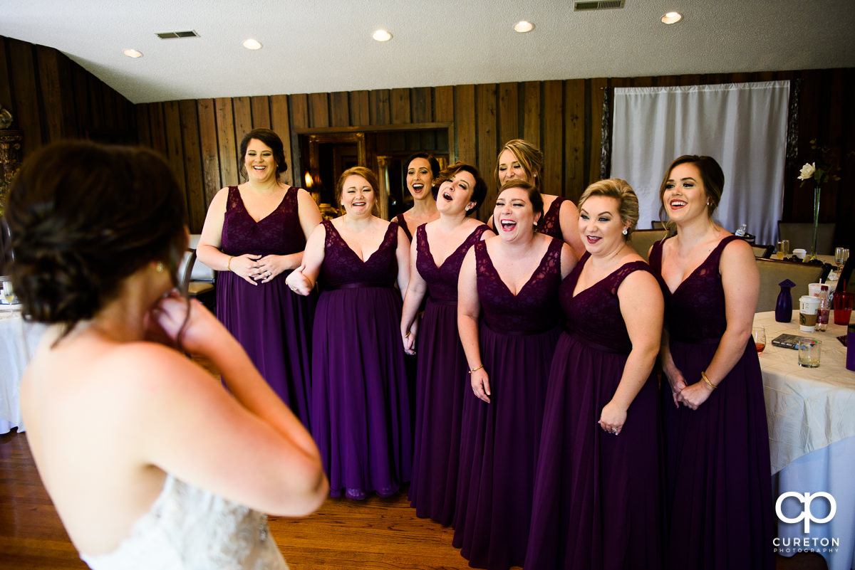 Bride reveals herself to the bridesmaids.