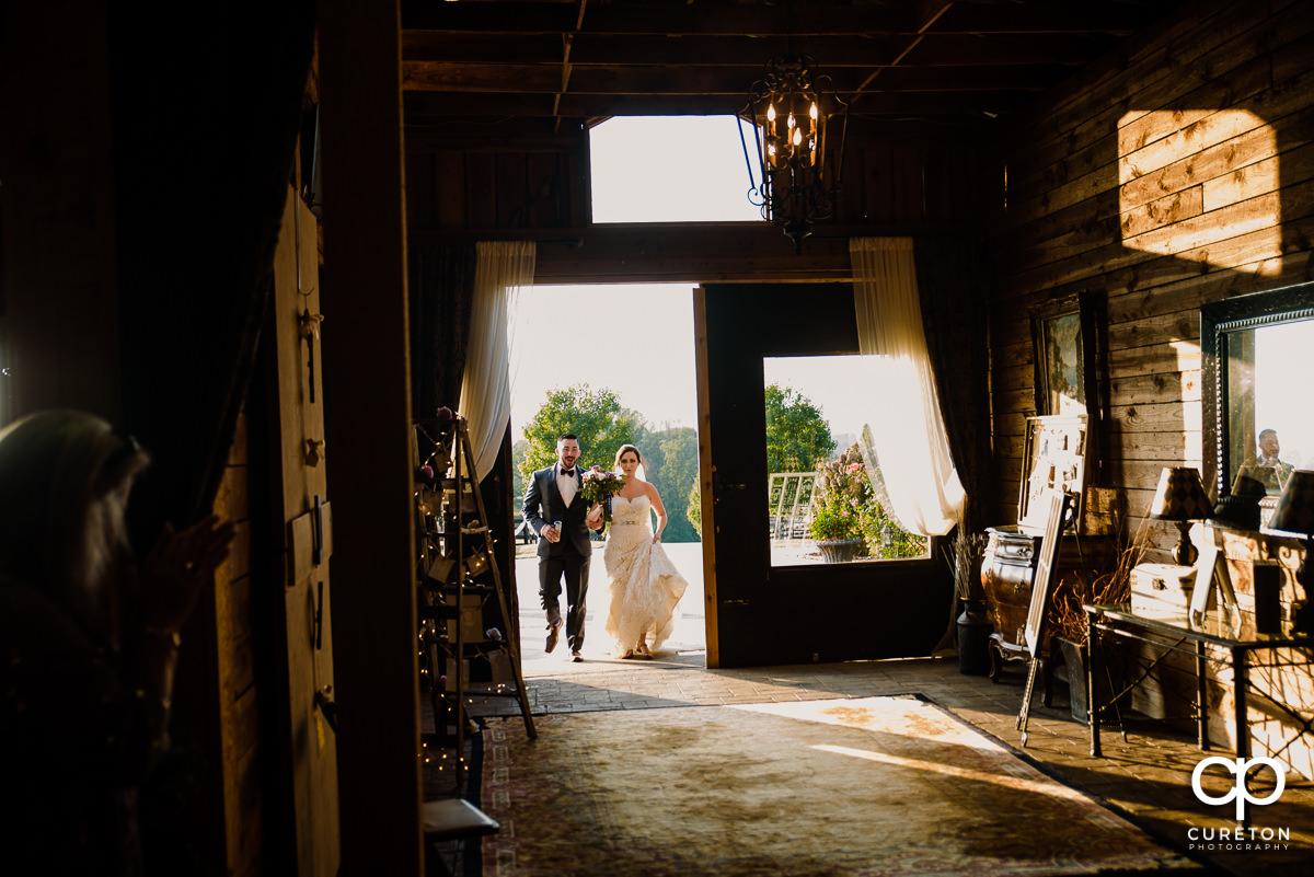 Bride and groom entering the reception.