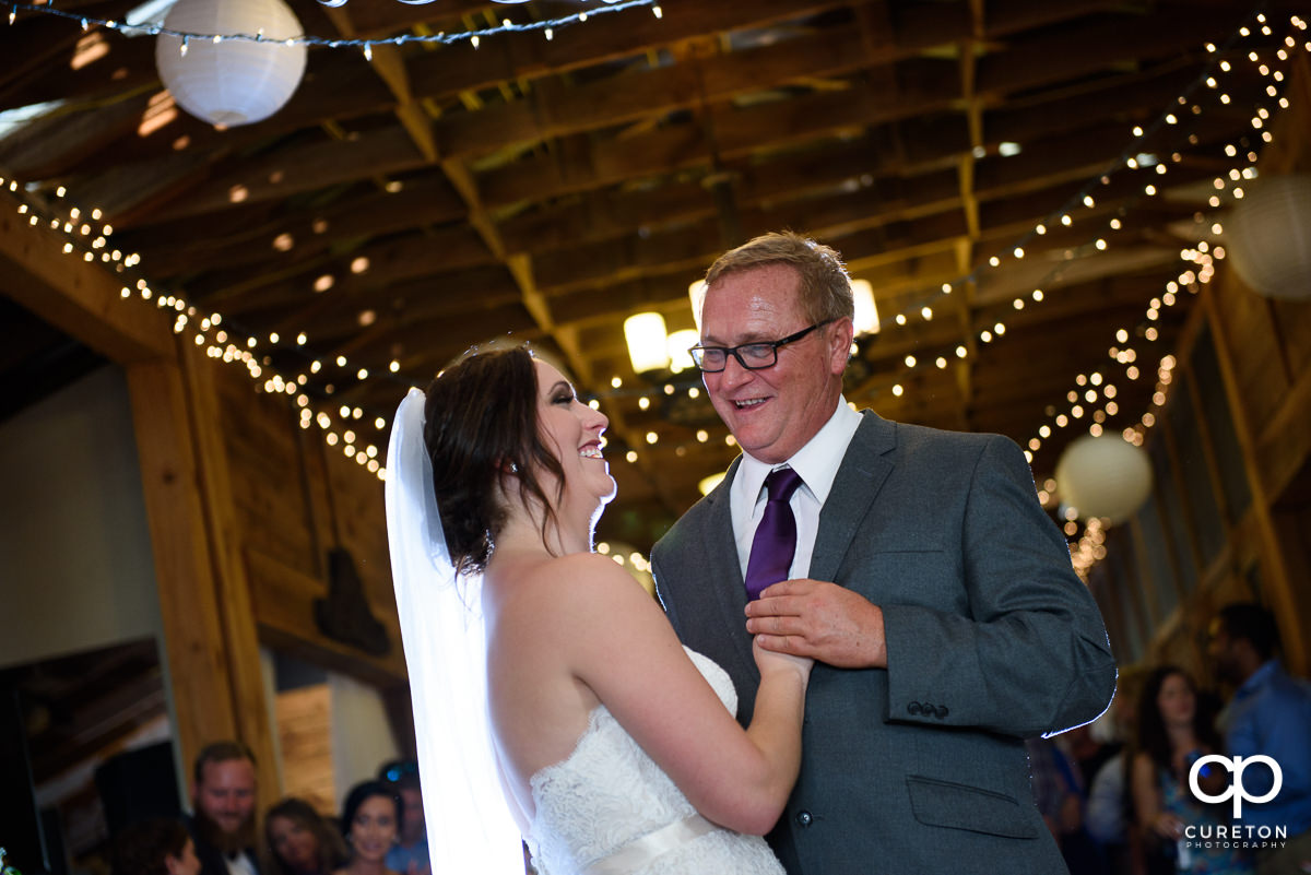 Bride and father having a dance at her wedding reception.