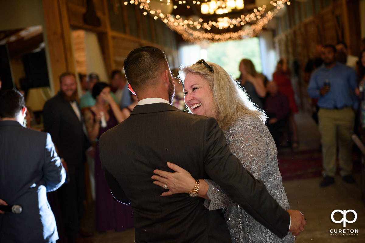 Mother dancing with her son, the groom.