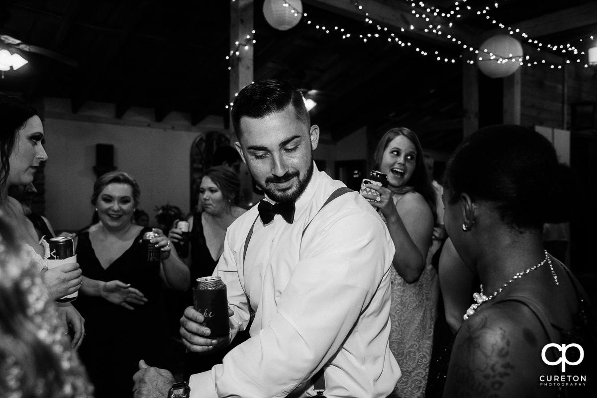 Groom dancing.