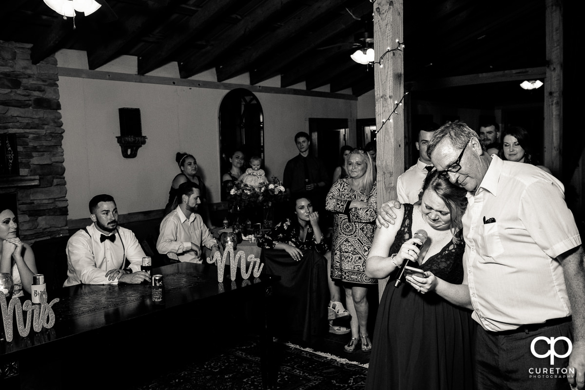Bridesmaids gives a touching speech at the reception.