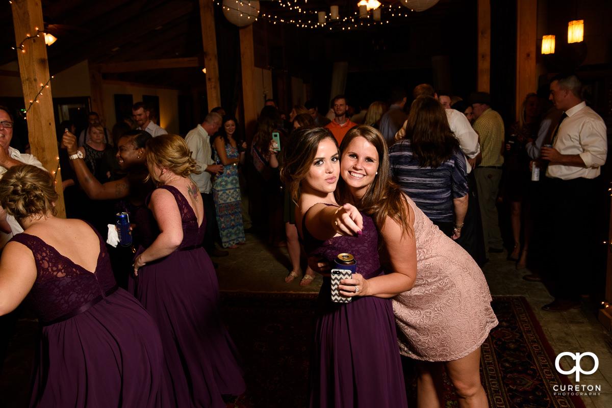 Bridesmaids dancing at the reception.