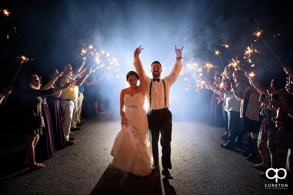 Bride and groom making a grand sparkler exit at Lindsey Plantation.
