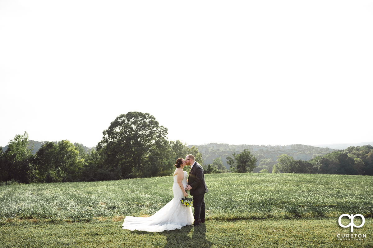 Bride and groom dancing in a field at their Lindsey Plantation wedding.