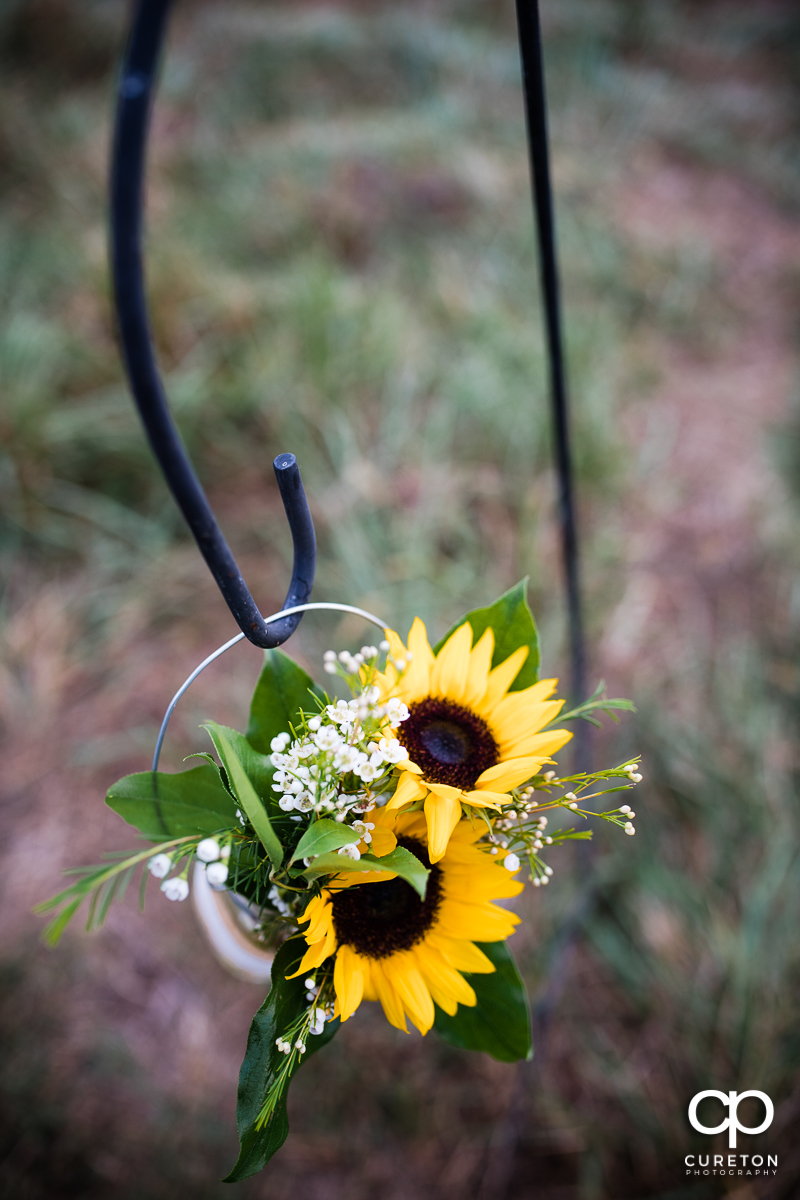 Sunflowers hanging at the ceremony.
