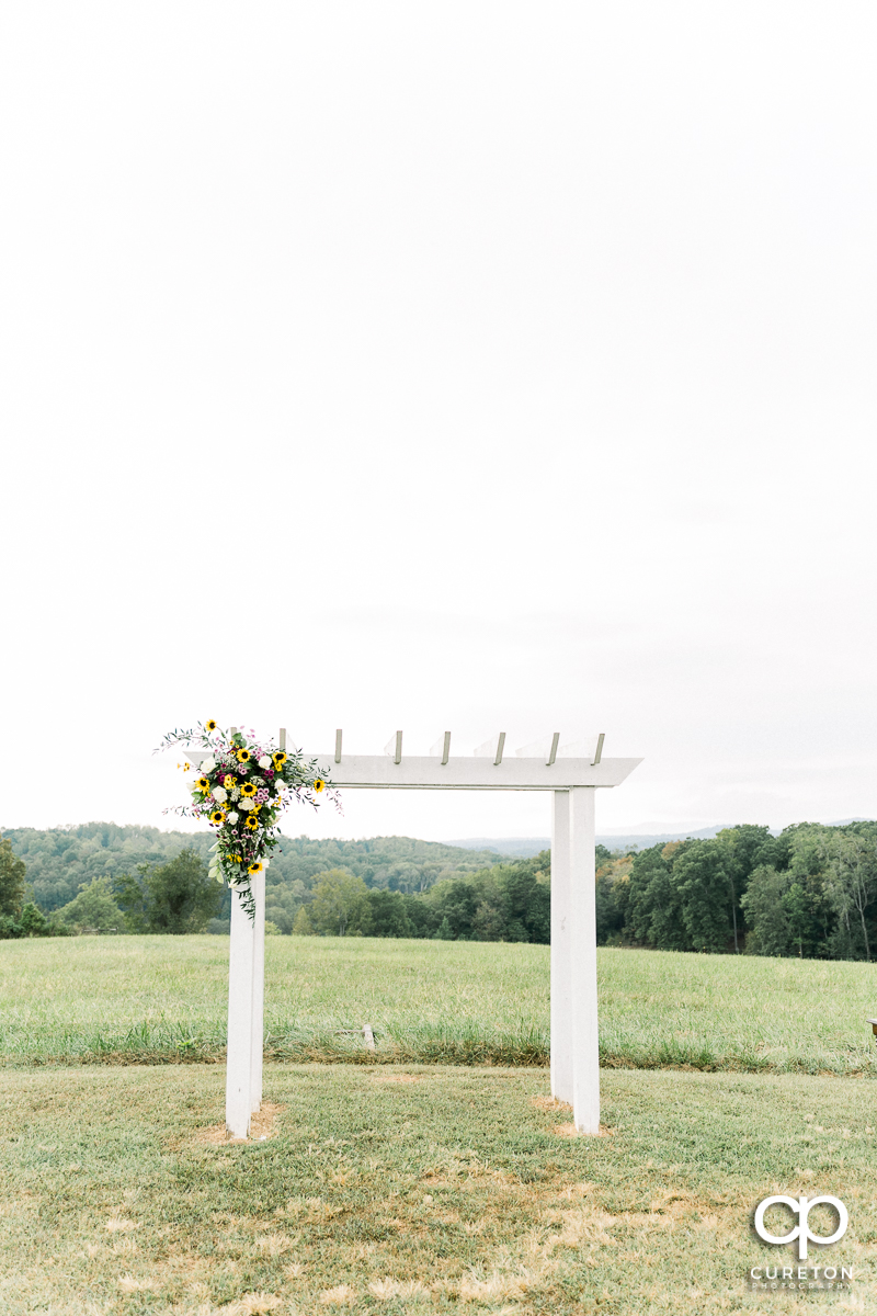 Wedding arbor in a field.