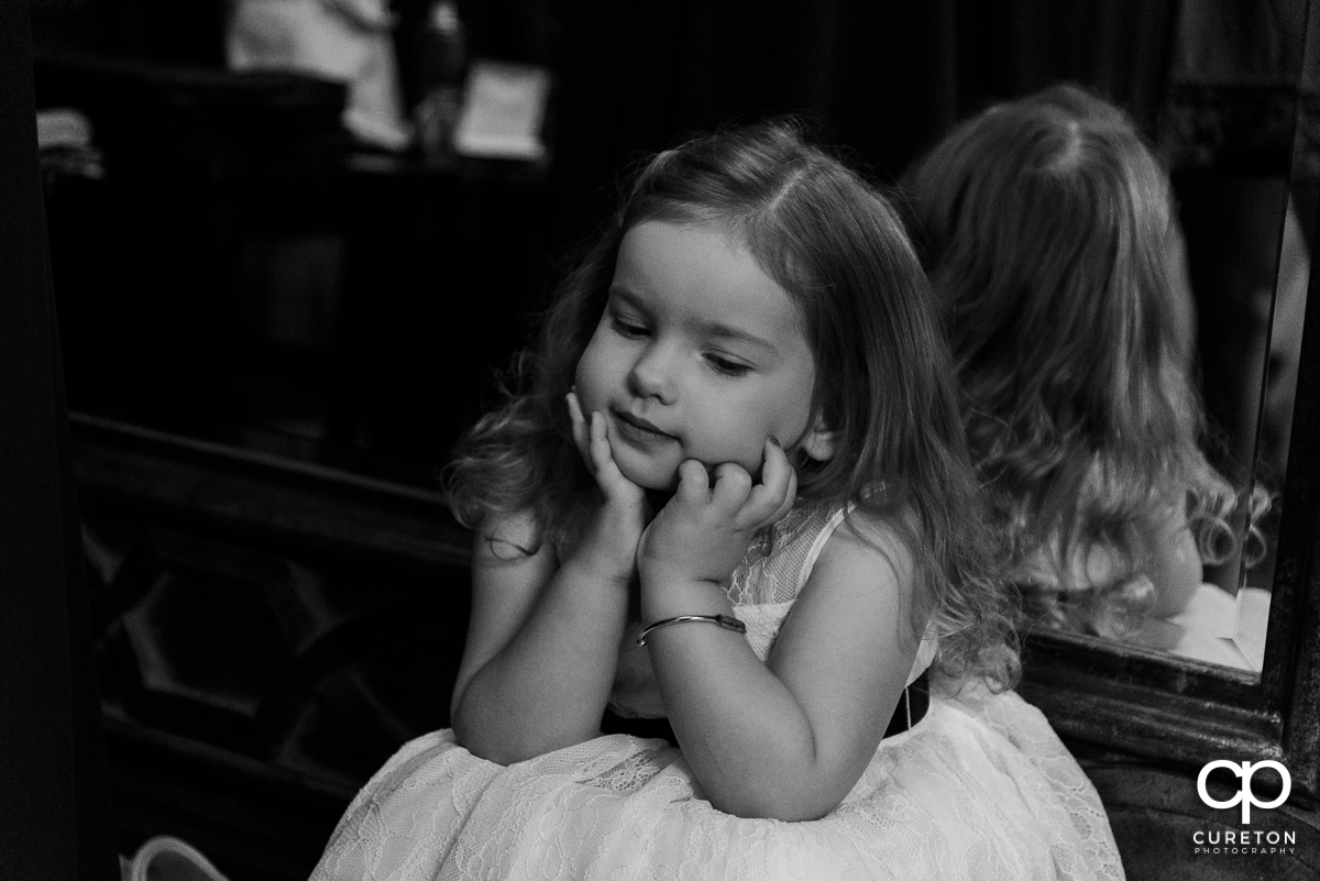Flower girl waiting for the wedding ceremony.