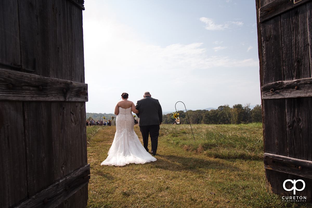 Bride and her dad walking down the aisle at their wedding at Lindsey Plantation in Taylors,SC.