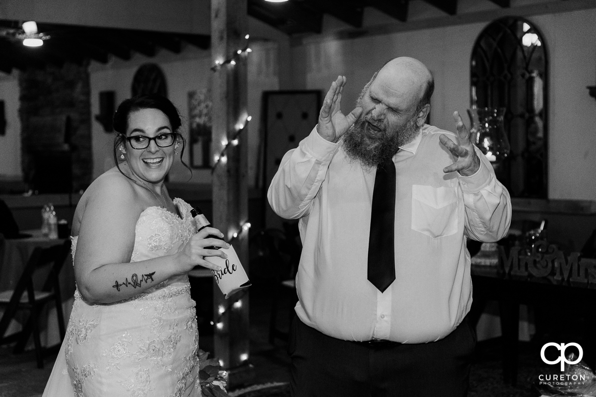 Bride's dad dancing.