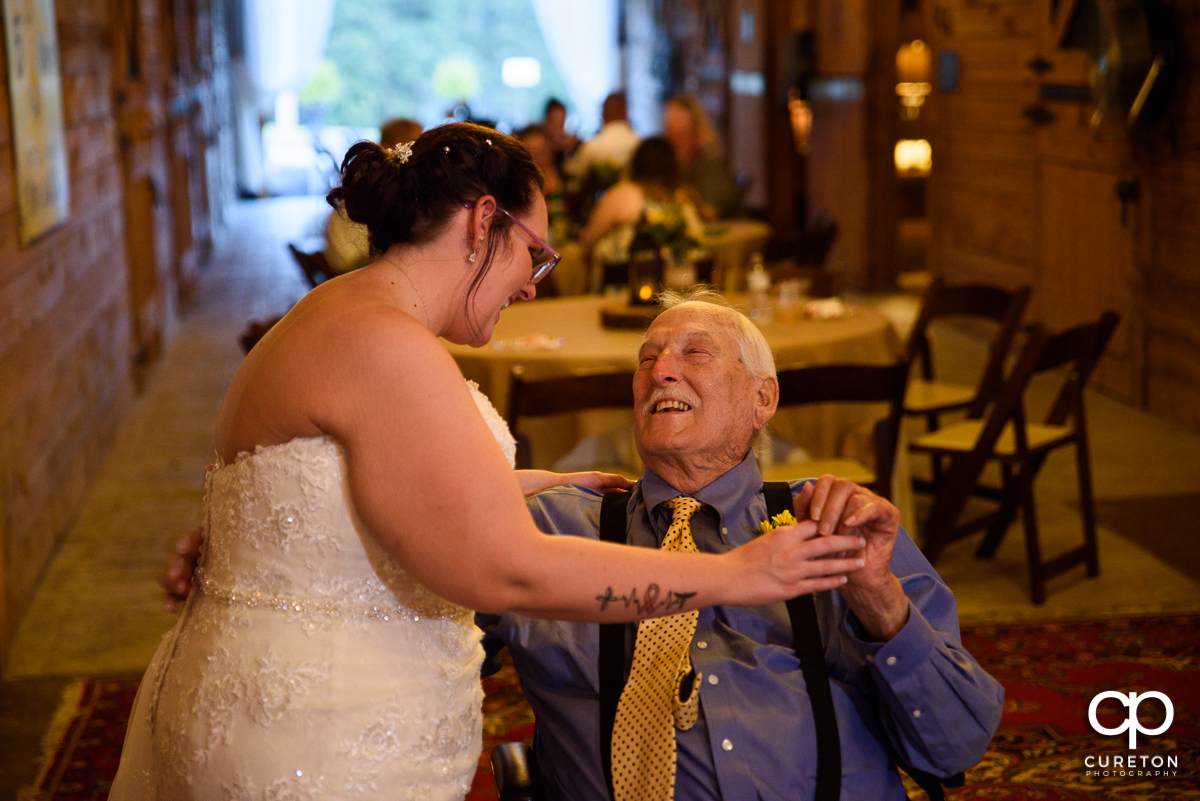 Bride dancing with her grandpa.