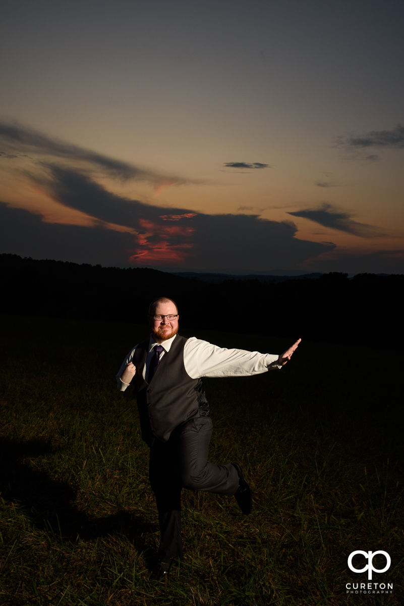 Groom doing the Heisman pose.