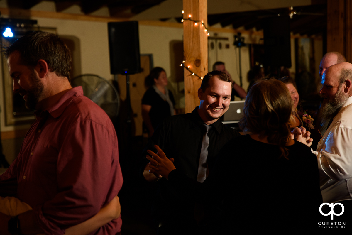 Wedding guests dancing to the Party Machine DJ at the wedding reception.