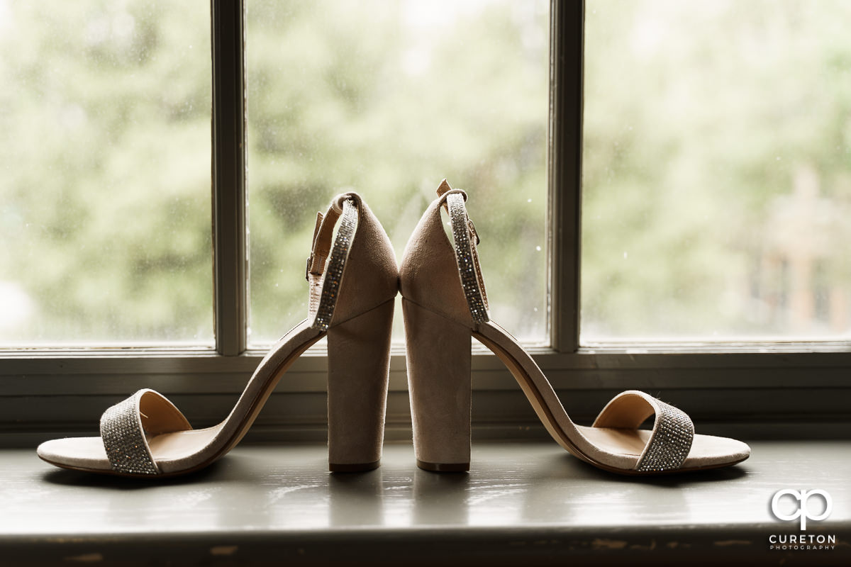 Bride's high heel shoes in the window at Soby's.