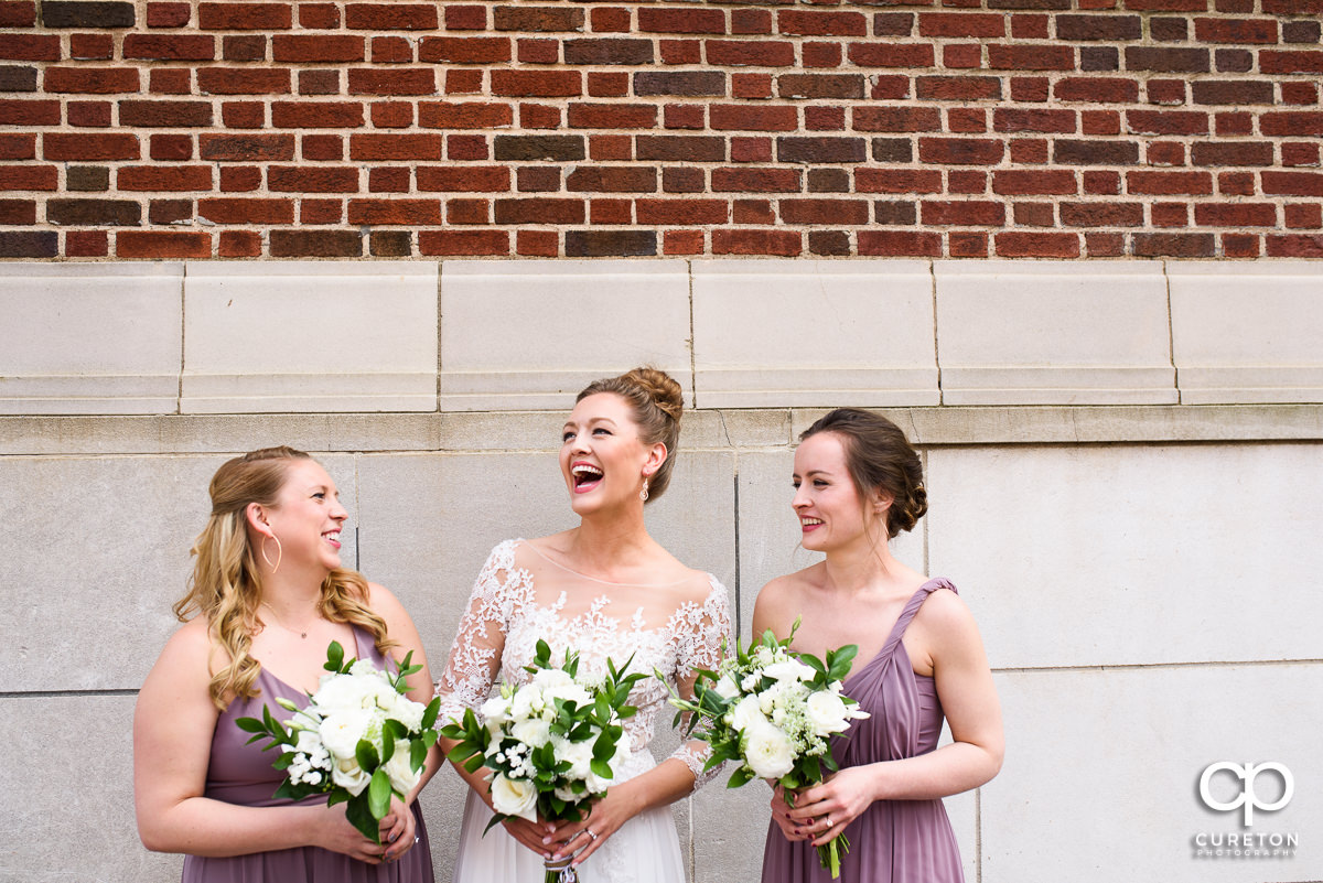 Bride laughing with her bridesmaids before her Loft at Soby's wedding in downtown Greenville,SC.