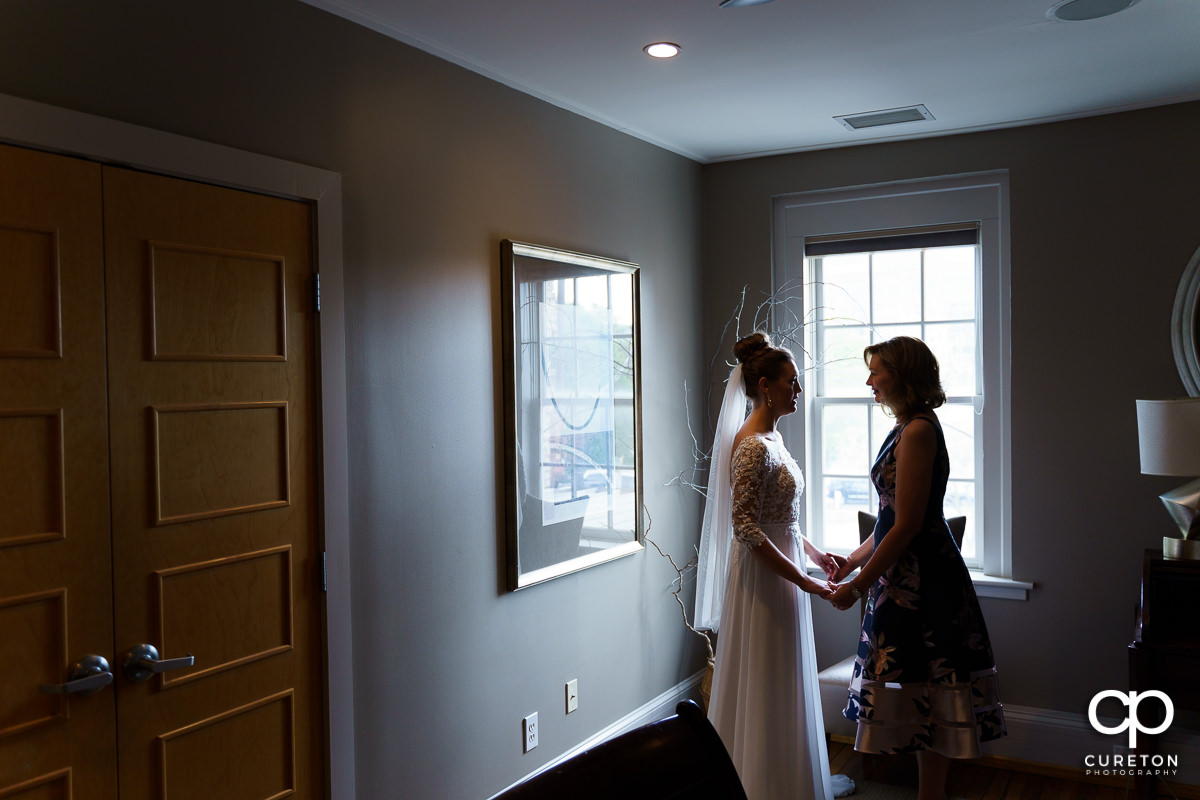 Mother and bride sharing a moment before the wedding.