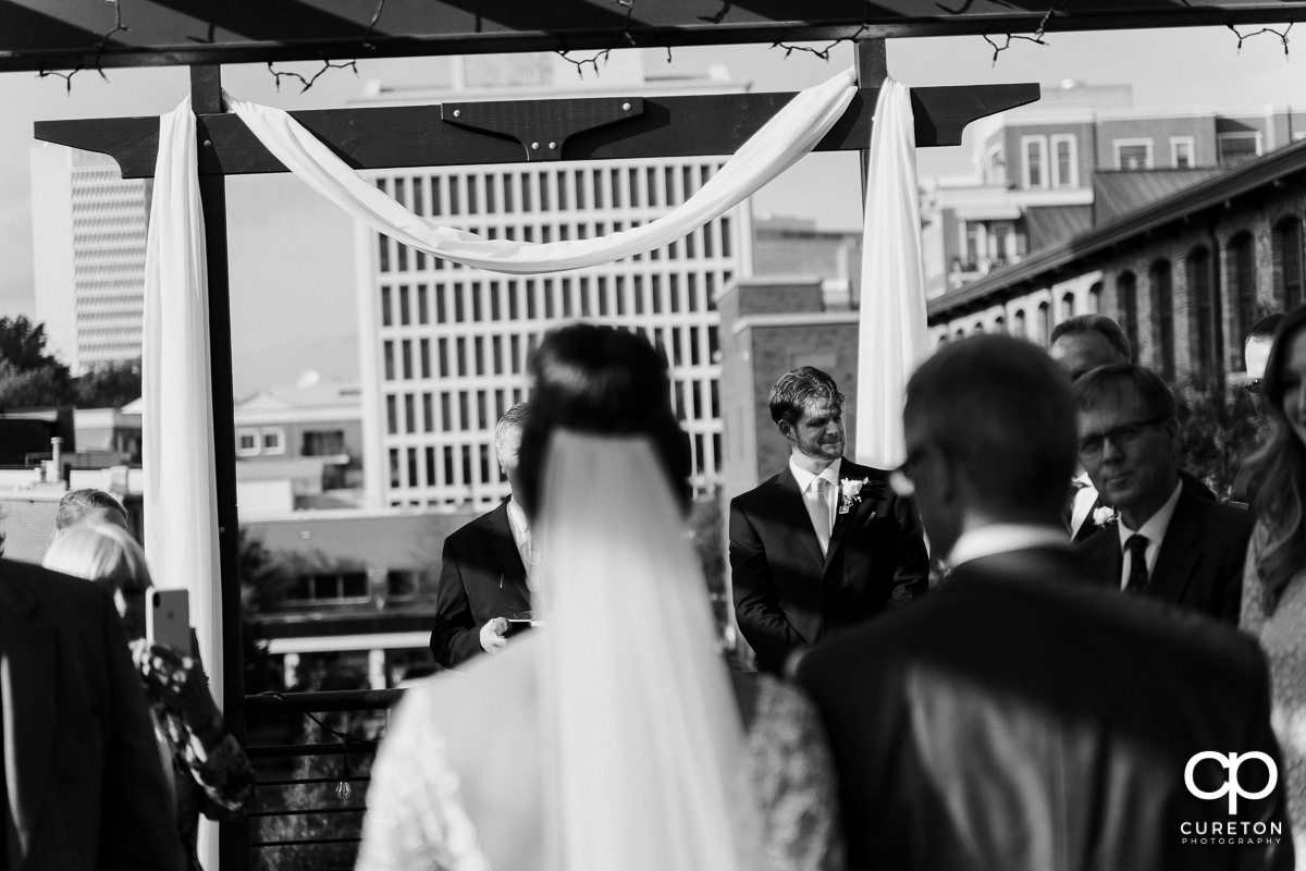 Groom getting emotional as he sees his bride walking down the aisle at their Loft at Soby's wedding in downtown Greenville,SC.