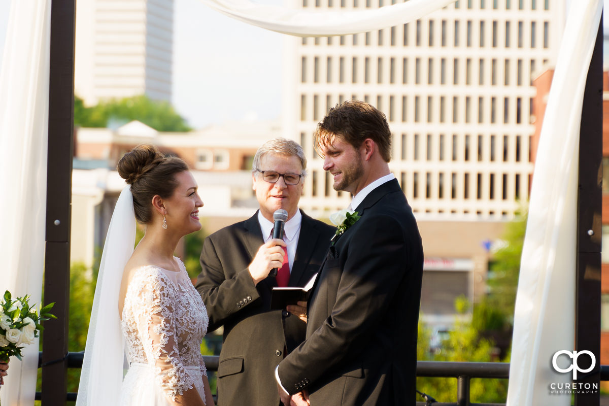 Bride and groom saying their vows on a rooftop in downtown Greenville,SC.