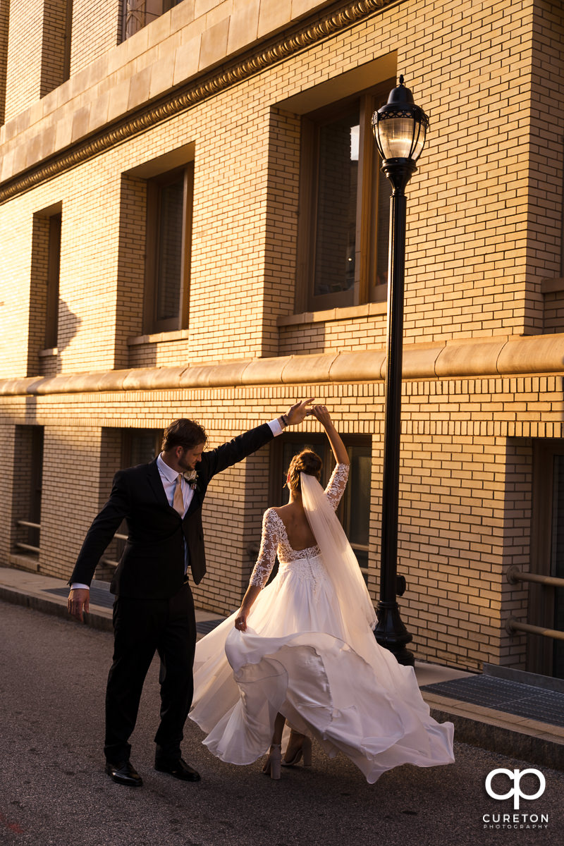 Bride and groom dancing in the streets of Greenville,SC.