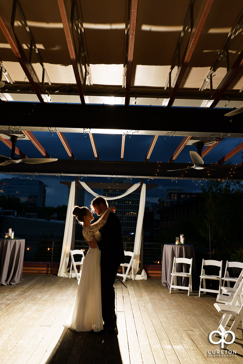 Bride and groom sharing a dance by themselves on a rooftop after their Loft at Soby's wedding in downtown Greenville,SC.