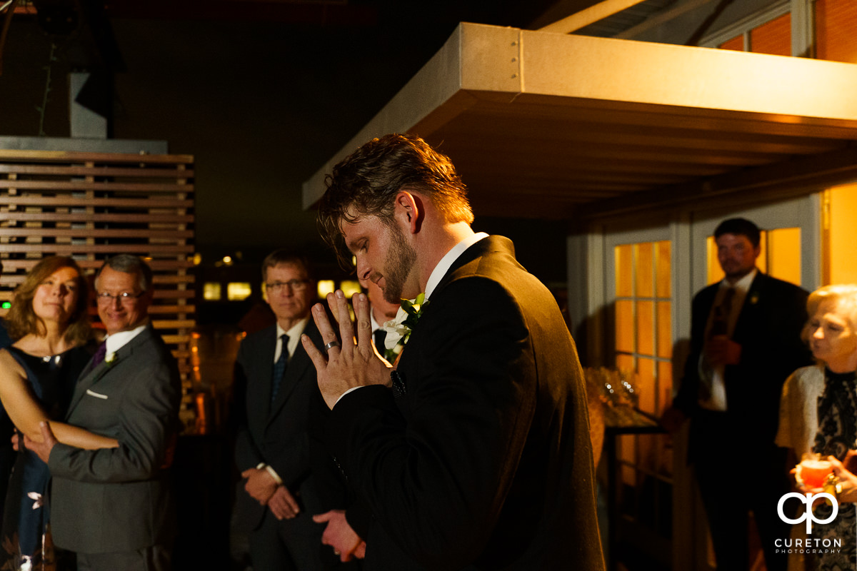 Groom at his reception.