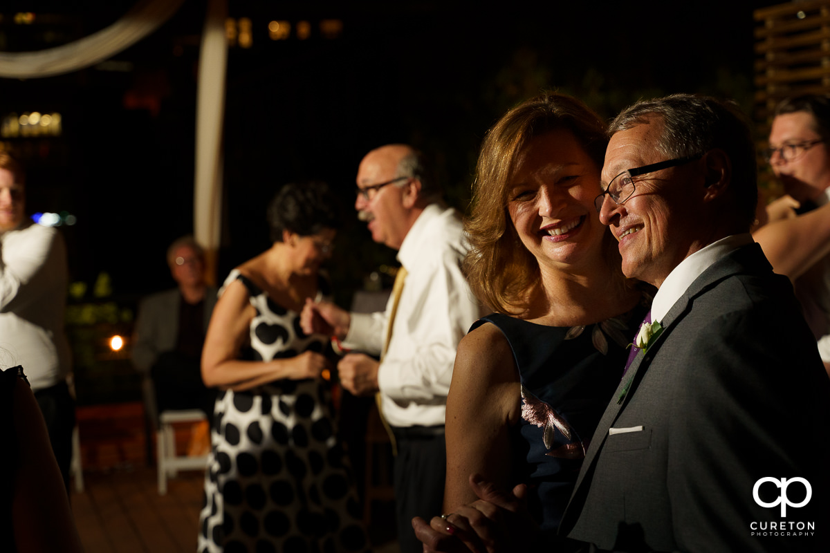 Guests dancing at the wedding reception on the rooftop at Soby's Loft in Greenville,SC.