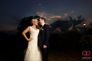 Bride and Groom pose at sunset during thier wedding reception at The Loom at Cotton MIll Place in Simpsonville.