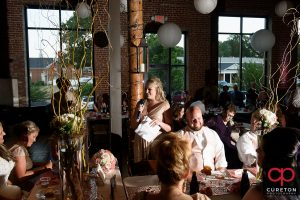 Bridesmaid giving a toast.