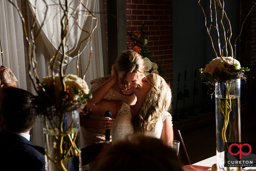 Bride's sisters sing a song for the bride.