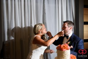 Bride and groom cutting the cake at The Loom.