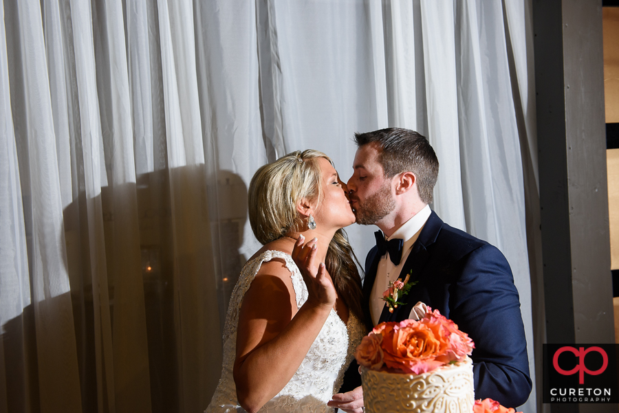 Bride and groom kissing.