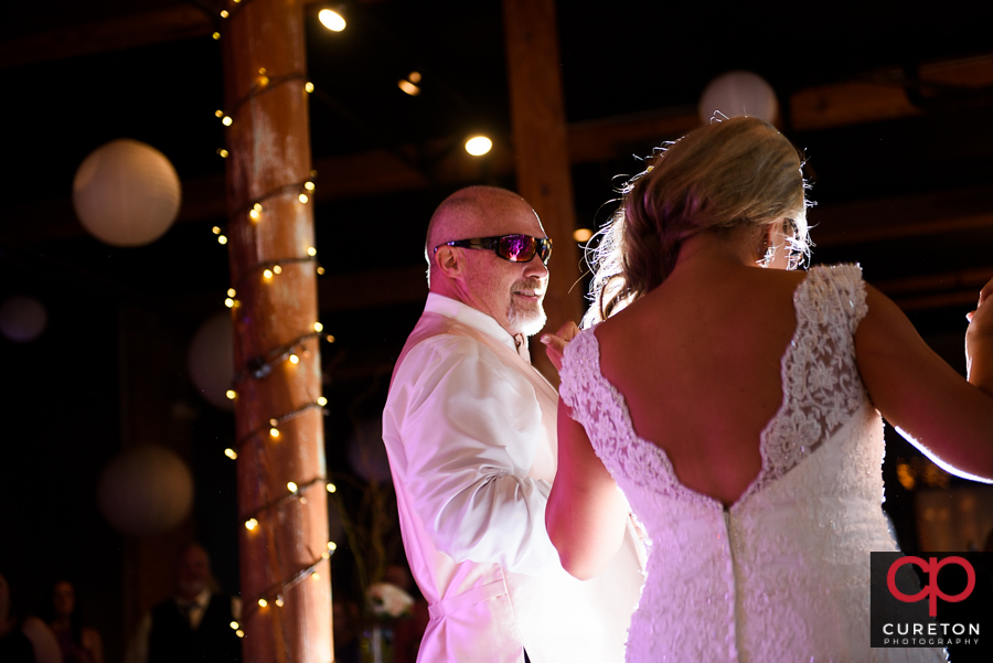 Bride dancing with her father in law.