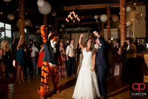 Bride and Groom dance with the Clemson Tiger at their wedding reception at The Loom at Cotton Mill Place.