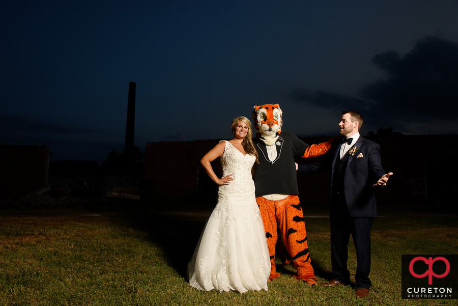 Bride and Groom outside the Loom with the Clemson Tiger.