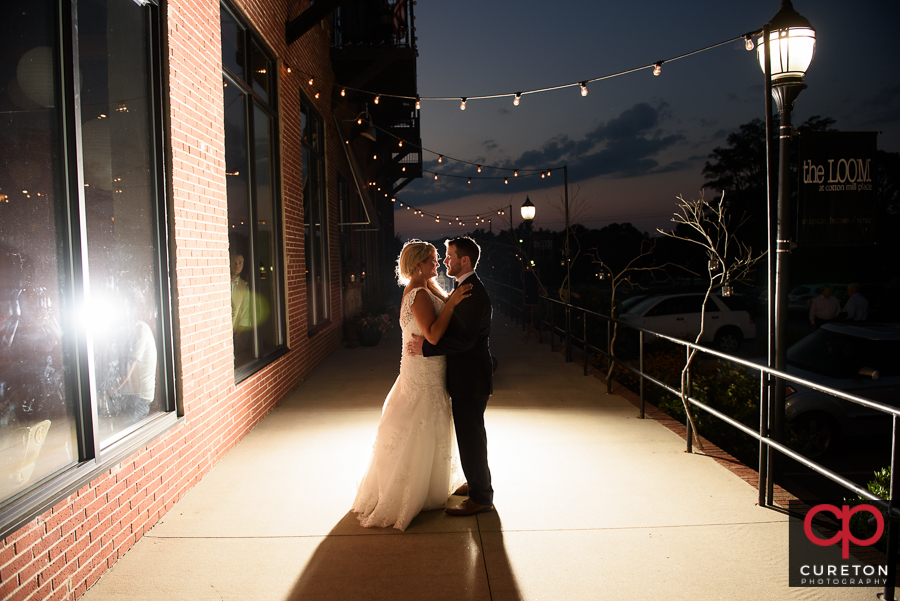 Bride and Groom outside the Loom at sunset.
