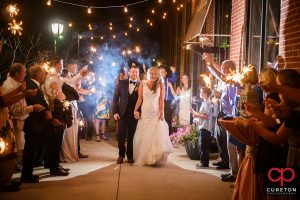 The bride and groom making an epic wedding exit through sparklers at The Loom.