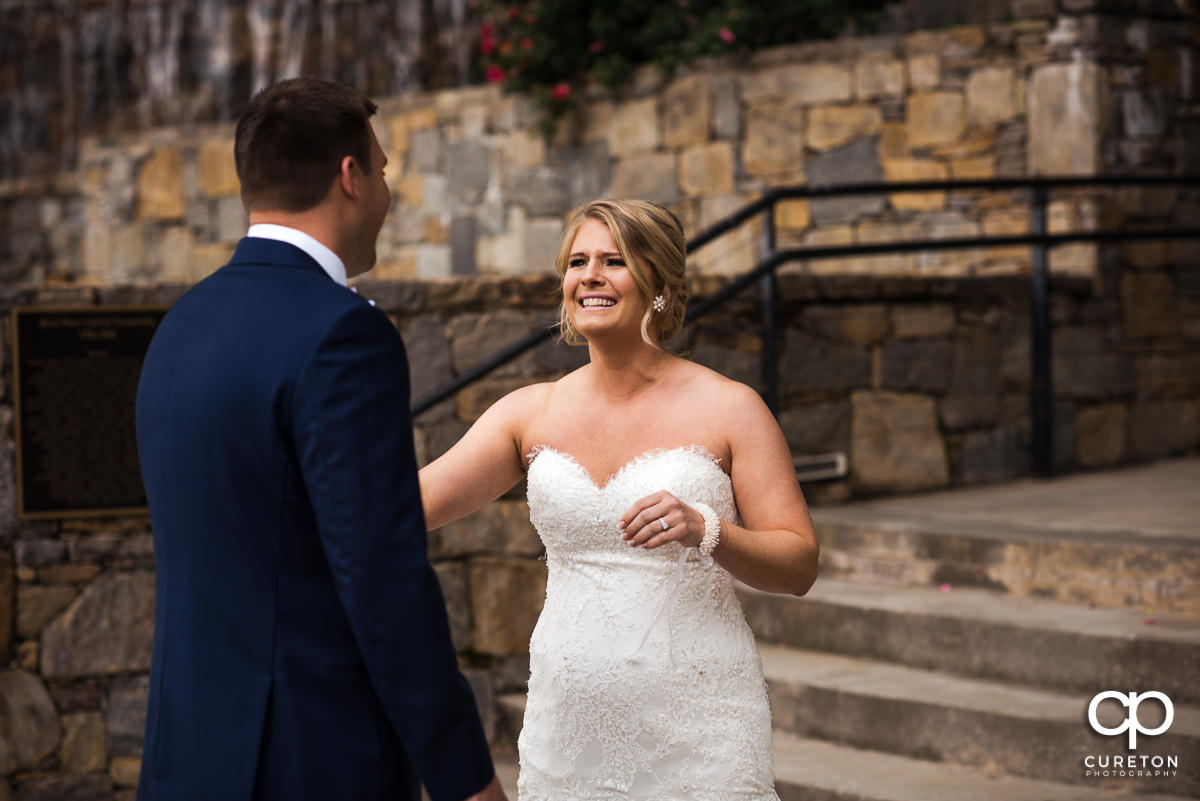 Bride sees her groom for the first time on the wedding day.