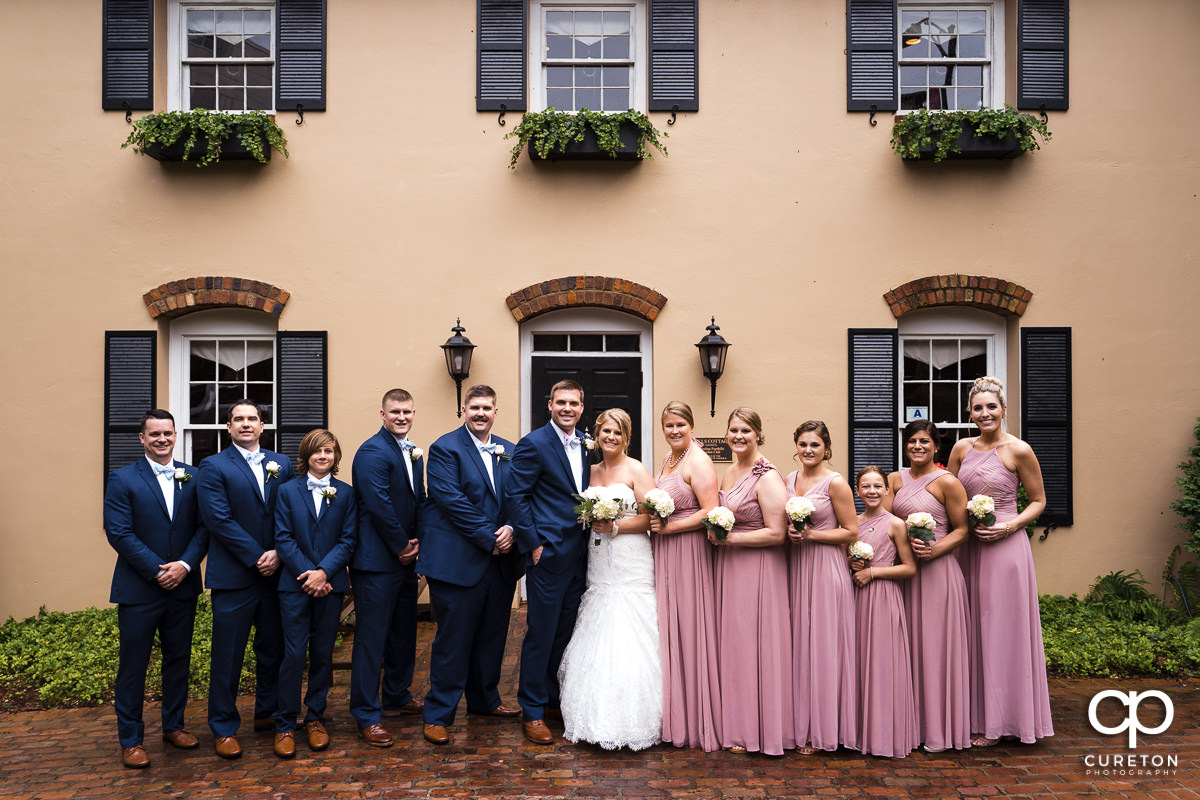 Wedding party in front of Marys at Falls Cottage before the ceremony.