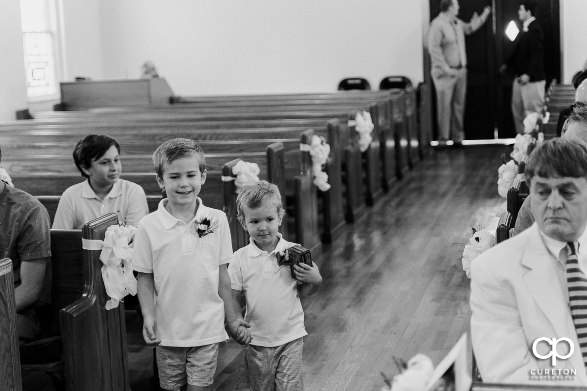 Ring bearers walking down the aisle.