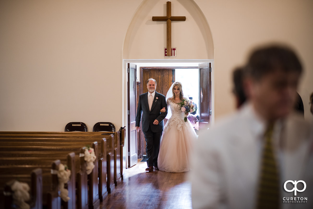 Bride making a grand entrance into the church.