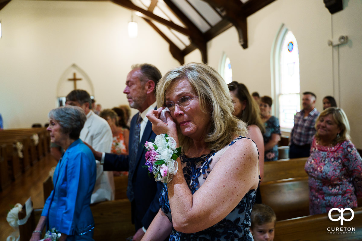 Bride's mother crying.