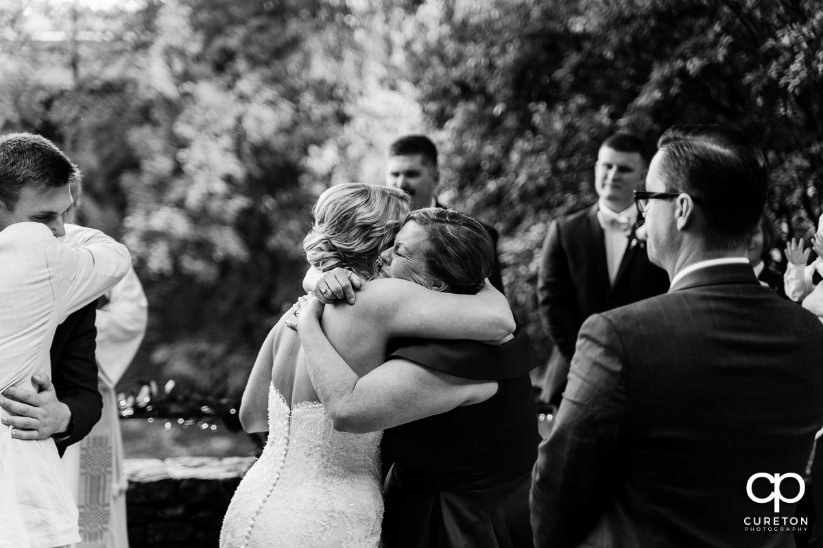 Bride hugging her mother at the ceremony.